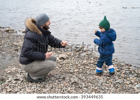 Father and child playing - stock photo