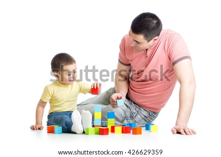 Father and child playing construction game together