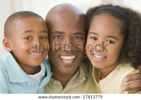 Father and children at home - stock photo