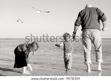Father and Children at Seashore - stock photo