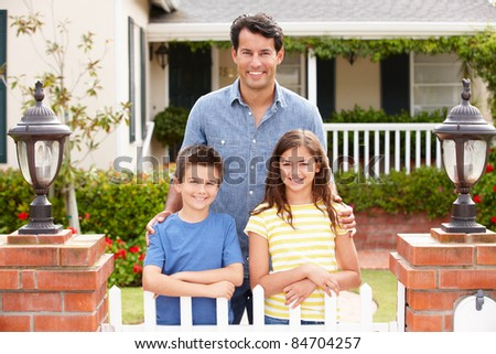 Father and children outside home - stock photo
