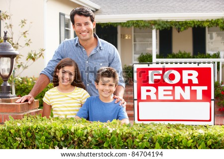 Father and children outside home for rent - stock photo