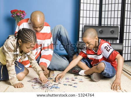 Father and children playing - stock photo