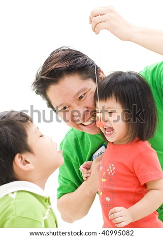 father and children playing yoyo - stock photo