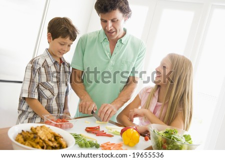 Father And Children Prepare A meal,mealtime Together - stock photo