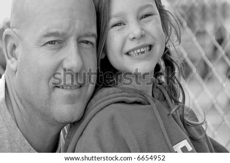 Father and Daughter at Ball Field - stock photo