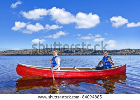 Father and daughter canoeing on Lake of Two Rivers, Ontario, Canada - stock photo