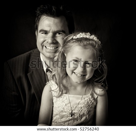 father and daughter close up on black - stock photo