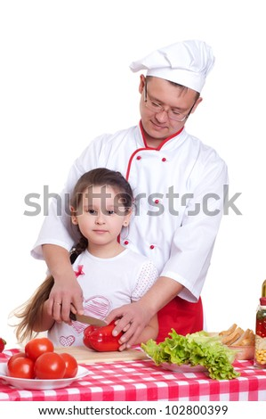 Father and daughter cooking a meal together - stock photo