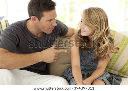 Father and daughter - Dad talking to his daughter  - stock photo