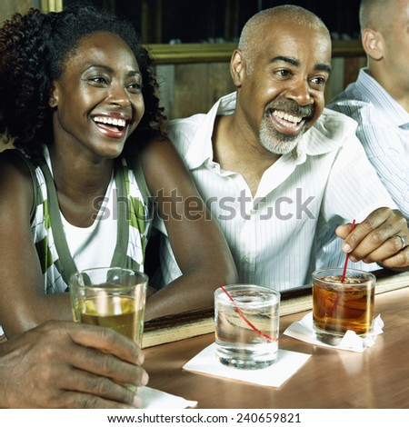 Father and Daughter Drinking in Bar - stock photo