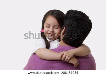 Father and daughter embracing over white background - stock photo
