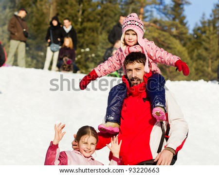 Father and daughter enjoying in winter - stock photo