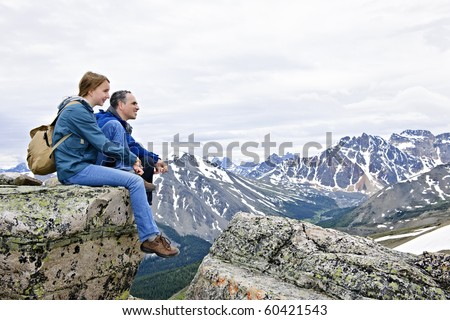 Father and daughter enjoying scenic Canadian Rocky Mountains view in Jasper National park - stock photo