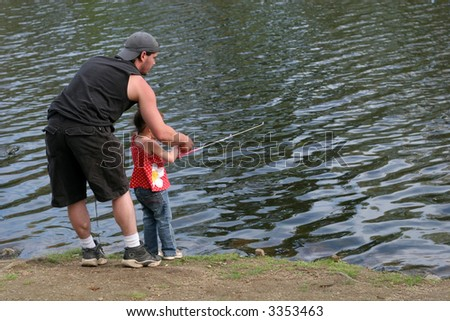 father and daughter fishing together - stock photo