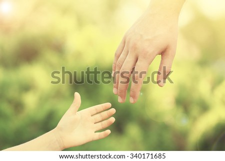 Father and daughter hands outdoors