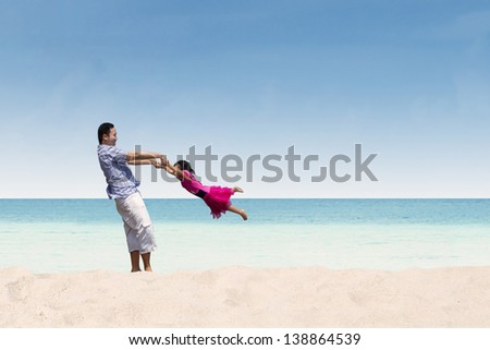 Father and daughter happy time at beach - stock photo