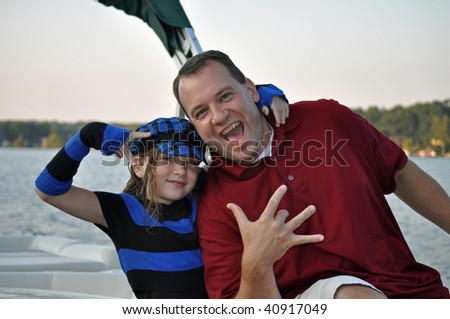 father and daughter having a hip hop moment on the boat - stock photo