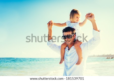Father and Daughter Having Fun at the Beach - stock photo
