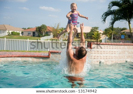 Father and Daughter Having Fun in Pool - stock photo