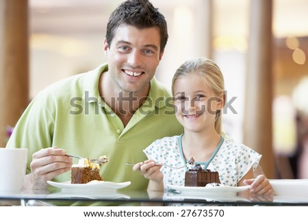 Father And Daughter Having Lunch Together At The Mall - stock photo