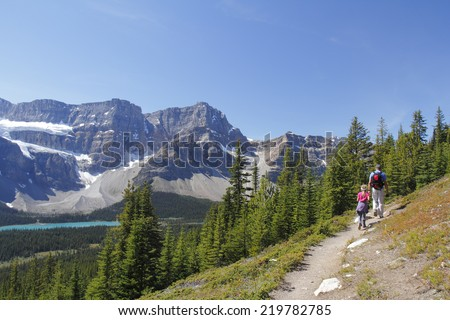 Father and Daughter Hiking on an an Alpine Trail in Jasper National Park - Alberta, Canada - stock photo
