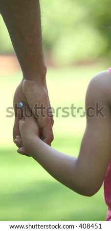 Father and daughter holding hands - stock photo
