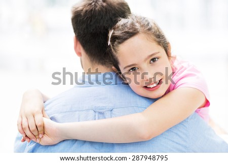 Father and daughter hugging  - stock photo