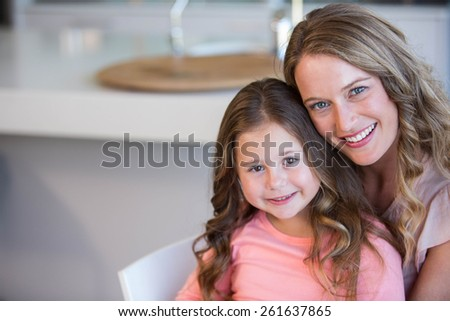 Father and daughter hugging at home - stock photo