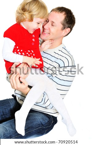 father and daughter hugging each other and playing - stock photo