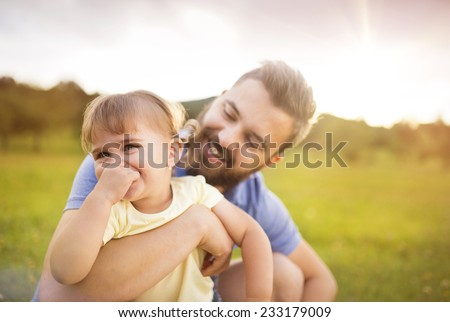 Father and daughter in nature - stock photo