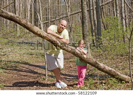 Father and Daughter in the Woods - stock photo