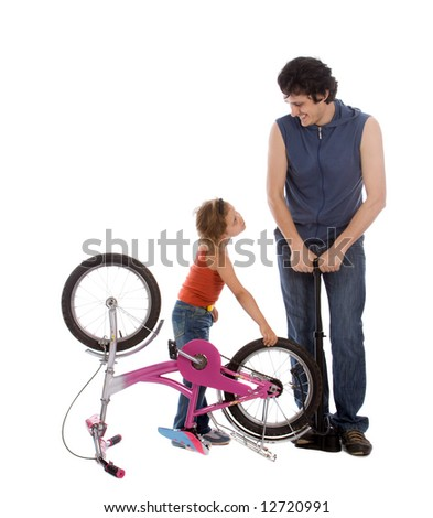 Father and daughter inflate wheel bike isolated on white - stock photo