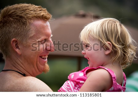 Father and Daughter laughing - stock photo