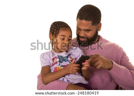 Father and daughter looking at a cell phone - stock photo