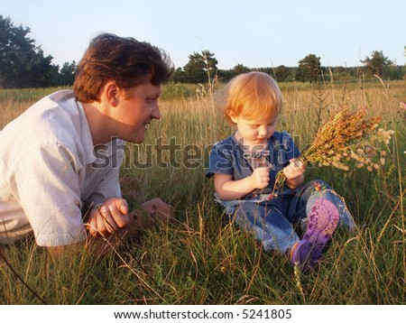 father  and daughter  on background grass