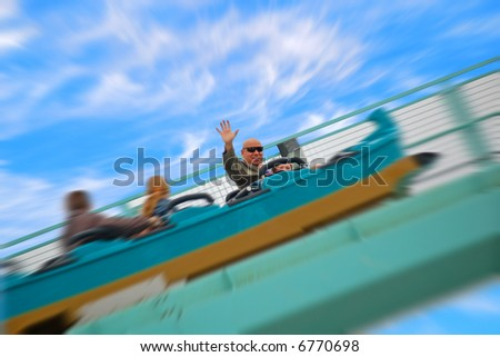 Father and Daughter on Ride at Amusement Park - stock photo