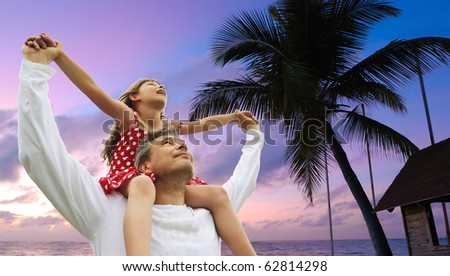 Father and daughter on shoulders against sky - stock photo