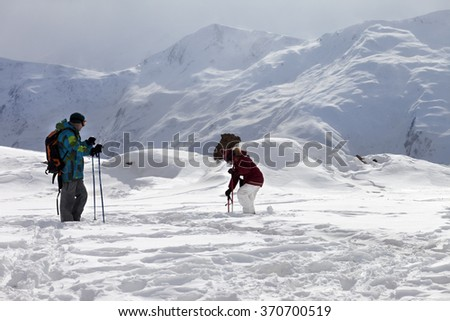 Father and daughter on ski resort after snowfall. Caucasus Mountains. Georgia, region Gudauri.