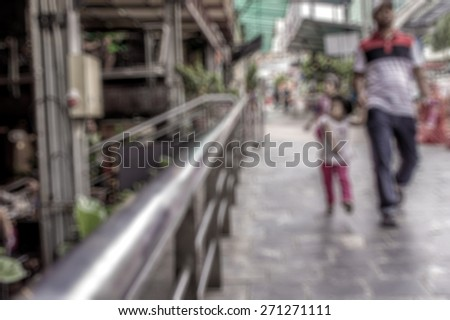 Father and daughter on street in defocused blur concept with vintage color style and effects. - stock photo