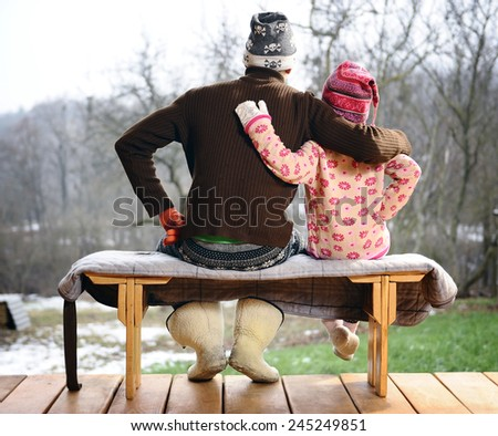 Father and daughter on the porch of a country house. - stock photo