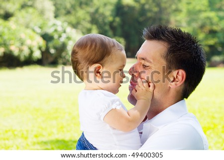 father and daughter outdoors - stock photo
