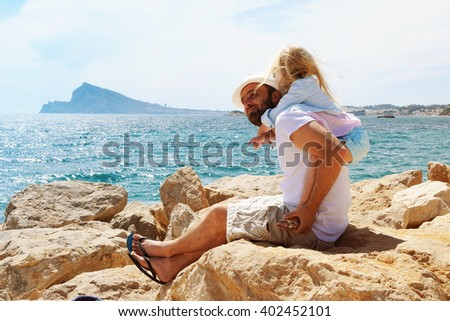 Father and Daughter Playing Together at the Beach. Summer vacation