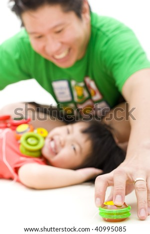 father and daughter playing yoyo - stock photo