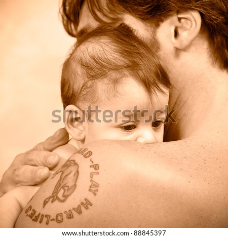 Father and daughter portrait. Sepia tone. - stock photo