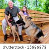 Father and daughter relaxing outdoors with family dogs - stock photo