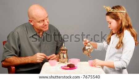 Father And Daughter Tea Party - stock photo