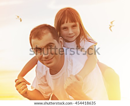 Father and daughter together. - stock photo