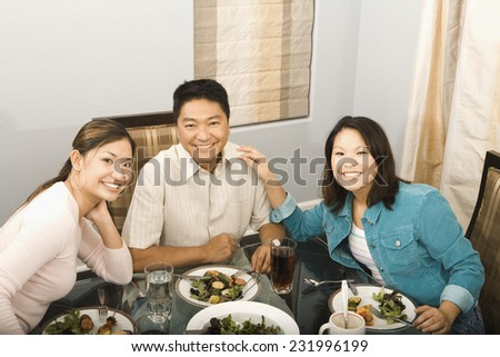 Father and Daughters at Eating Dinner - stock photo