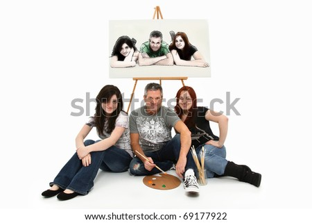 Father and Daughters sitting with easel family portrait over white background cutout.